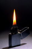 Lighting flame on dark background Royalty Free Stock Photos
