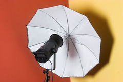 Lighting flash-heads with umbrella. In the studio stock image