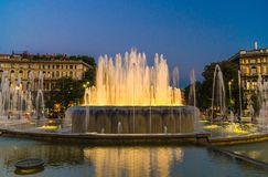 Lighting fountain Fontana di Piazza Castello square, Milan, Italy stock image