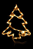 Lighting a garland. In the form of a fur-tree Royalty Free Stock Photos