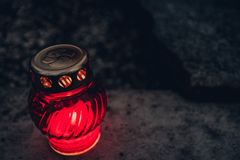 Lighting grave candle at night royalty free stock photos
