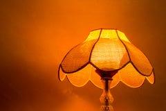 Lighting home lamp besides stucco wall Stock Photography