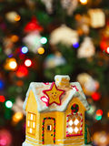 Lighting house and christmas tree Stock Photos