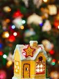 Lighting house and christmas tree Stock Photos