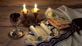 A table set for Shabbat with challah bread, candlesticks and wine. wood background. Lighting Jewish Candlestick table set for Shabbat with challah bread stock video footage