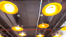 Lighting lamps with black ceiling Stock Images