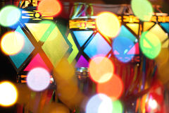 Lighting and Lanterns. A view of traditional Diwali lanters through colorful lights out of focus Royalty Free Stock Photos