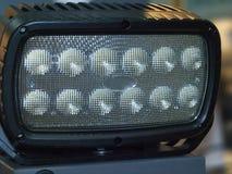 Lighting LED flashlight. Black LED flashlight with a blurred background royalty free stock photo