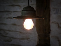 Lighting light bulb on the cable in dark room.  Stock Photography