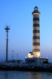 Lighting lighthouse in Lido di Jesolo, Italy. At the mouth of the river Sile in Lido di Jesolo near Venice along the Gulf of Venice in Italy there is the Stock Photo