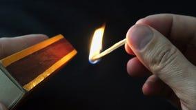 Lighting a match stick 4K stock video footage