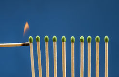 Lighting the matches. Stock Photo
