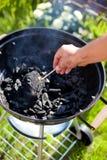 Lighting a matchstick, burn up a coal Stock Photo