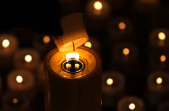 Lighting a memorial candle Royalty Free Stock Photography