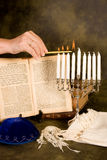 Lighting the menorah Stock Images