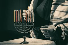 Lighting Menoral Candles. On Jewish candle lights Stock Images