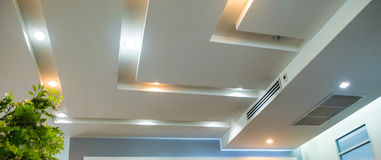 Lighting on office ceiling. Lighting on the modern office ceiling royalty free stock photos