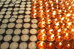 Lighting oil candles in temple Stock Photos