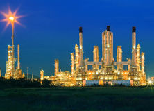 Lighting of oil refinery palnt against dusky blue sky of oil re Royalty Free Stock Images