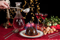 Lighting the plum pudding Royalty Free Stock Photo