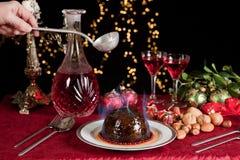 Lighting the plum pudding Royalty Free Stock Photo