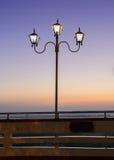 Lighting pole at sunset Royalty Free Stock Image