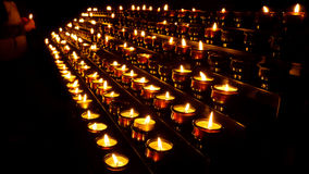 Lighting Prayer Candles in a Church Royalty Free Stock Photos