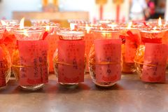 Lighting of Praying candles in a temple. Lighting of Praying candles in a temple at Penang. Devotee light the candles and make their wish/request to the Buddha stock photo