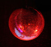 Lighting red mirror-ball. Night club lighting red mirror-ball over black Stock Photography