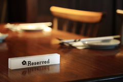 Lighting Reserved sign on a restaurant table Stock Photo