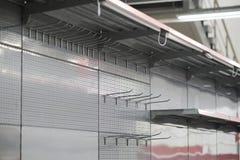 Lighting for retail shelving, empty store shelves Stock Photos