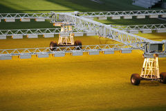 Lighting rig system for growing grass and lawn at stadium Stock Images