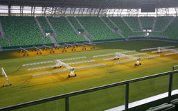 Lighting rig system for growing grass and lawn at stadium Stock Photos