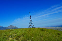 Lighting rod on the top of the mountain Royalty Free Stock Images
