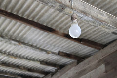 Lighting in rural area. An isolated light bulb is the source of night vision for the rural people royalty free stock photos
