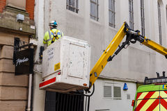 Lighting services workman in a truck-based cherry picker. Royalty Free Stock Image