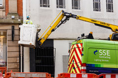 Lighting services workman in a truck-based cherry picker. Royalty Free Stock Photography