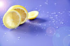 Lighting on Fresh Lemon with Water Drop on Background Stock Images