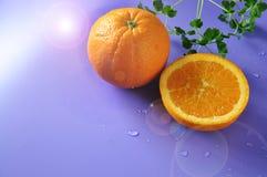 Fresh Navel Orange on Blue Background Royalty Free Stock Images