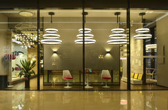 Lighting shop window. Luxury modern lighting shop window exhibit   modern pendant lamps,floor lights and desk lamps.luxury show window in a lighting mall,China Royalty Free Stock Photo