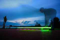 Lighting skateboard with rider on long exposure Stock Image