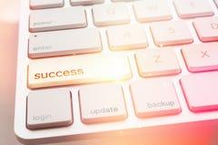 Lighting spark under success key of computer keyboard Stock Images