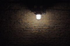 Lighting spot on brick wall Stock Photos