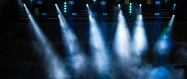 Lighting the stage during a musical rock concert and artificial stock images
