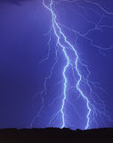 Lighting strike. In the blue sky Royalty Free Stock Photography