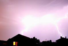 Lighting strike. Summer thunder-storm above populating area near Riga Royalty Free Stock Photography