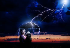 Lighting strikes couple Royalty Free Stock Photo