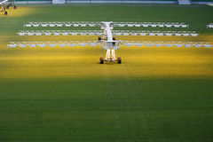 Lighting system for growing grass and lawn at stadium Stock Images