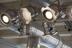 Lighting system. Spotlights and ceiling lights. Air conditioning system in the background. Shop interior stock photo