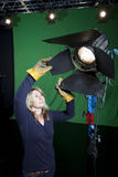 Lighting technician in Television Studio Royalty Free Stock Images